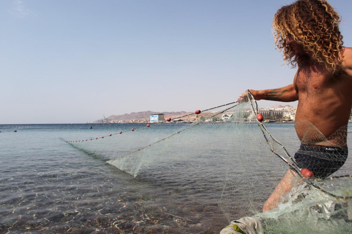 рыбаками сети
