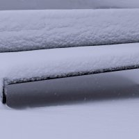 Спит скамейка под пушистым снегом... :: Nina Streapan