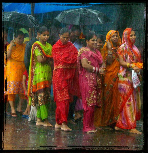 Monsoons Showers Indian women colorful saris
