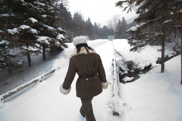 Женщина, служит в военной части Северной Кореи.