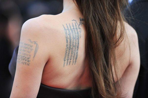 64-й Канский Фестиваль, знаменитые татуировки Анжелины Джоли, фото: Pascal Le Segretain