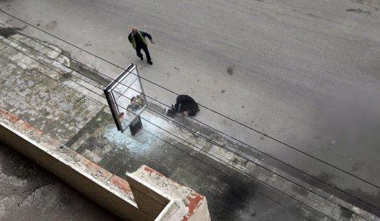 Раненный журналист после обстрела 11 января 2012 года