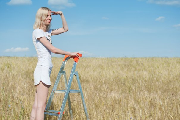 Woman looks forward in the field