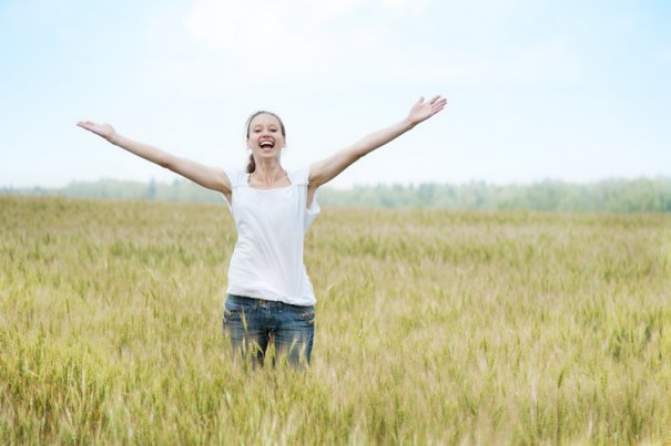 Happy woman in the field