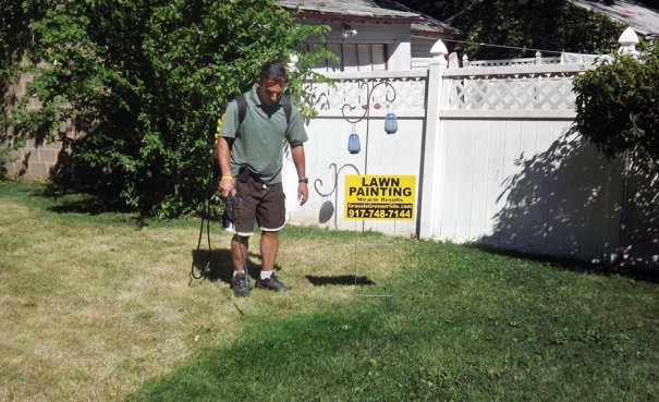 AP Photo/Grass is Greener Lawn Painting