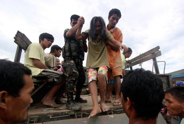 Karlos Manlupig/Associated Press