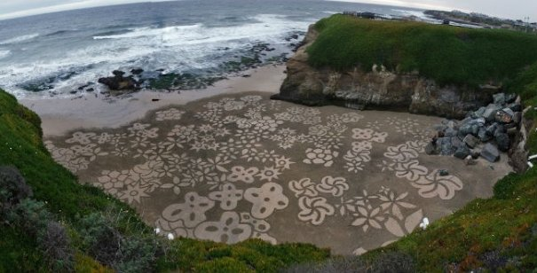 Фотографии рисунков на песке - №8