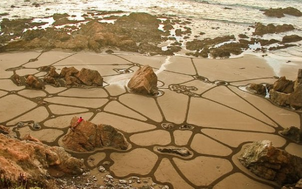 Фотографии рисунков на песке - №9