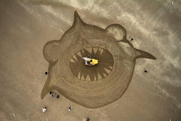 рисунки на песке фото