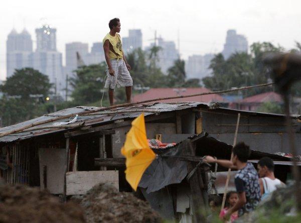 Новости в фотографиях - Тайфун Хаян унес жизни более 10 тысяч человек - №1