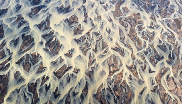 Воздушные красивые фото вулканических рек Исландии - №15